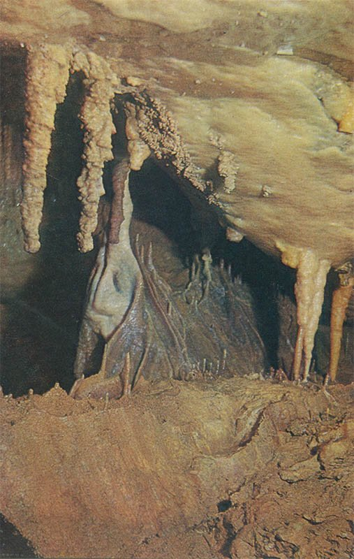 Stalactite curtains and draperies. New Athos Cave, 1980
